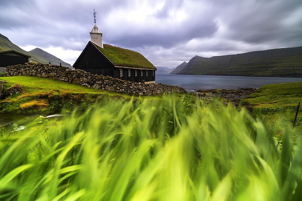 Church with traditional grass roof, oceanfront, Funningur, Eysturoy island, Faroe Islands, Denmark, Europe