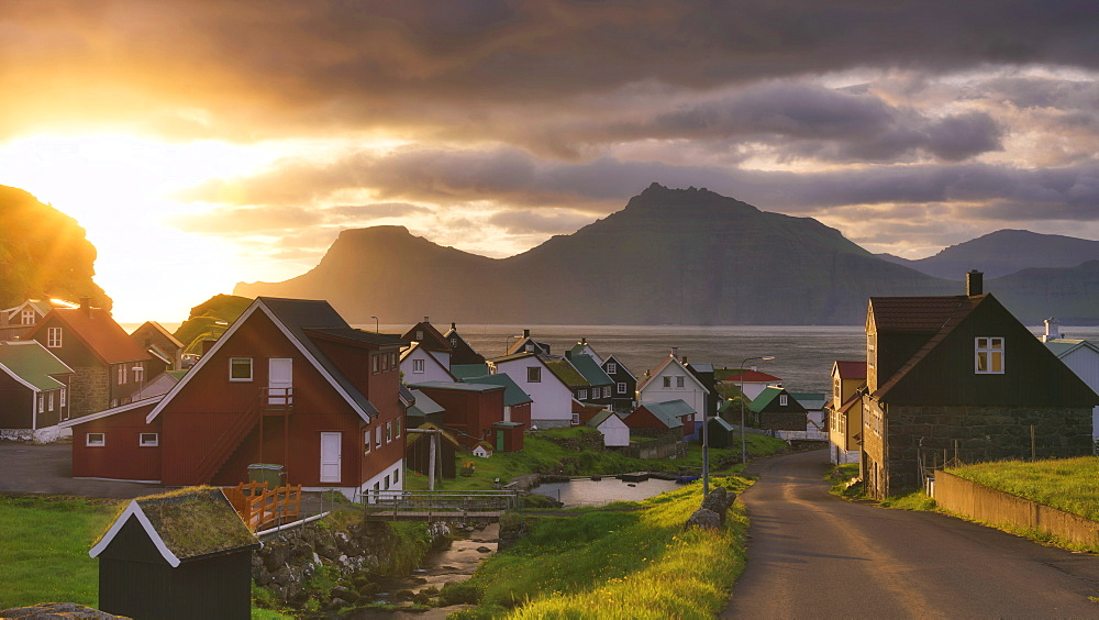 Sun rays on the traditional village, Gjogv, Eysturoy island, Faroe Islands, Denmark, Europe