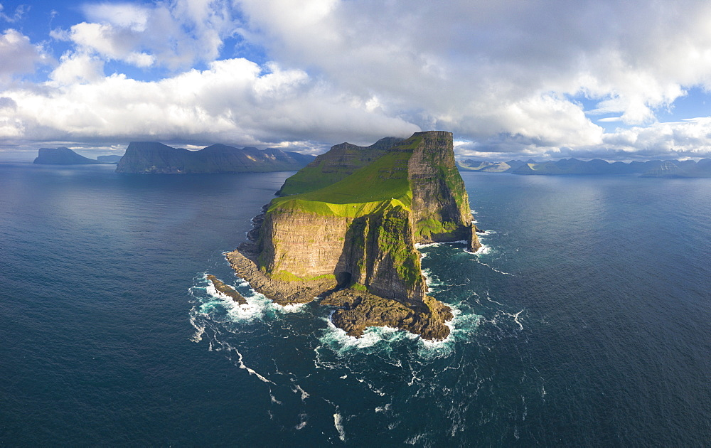 Aerial panoramic of Kallur lighthouse and cliffs, Kalsoy island, Faroe Islands, Denmark