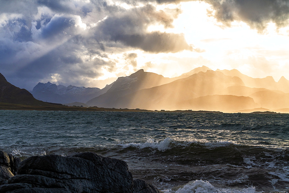 Sun rays above the rough sea of Flakstadoya seen from Vareid, Nordland, Lofoten Islands, Norway, Europe