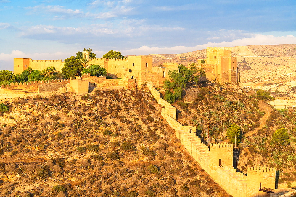 Ancient defensive walls of Alcazaba Moorish fortress in the arid landscape of mountain valley, Almeria, Andalucia, Spain