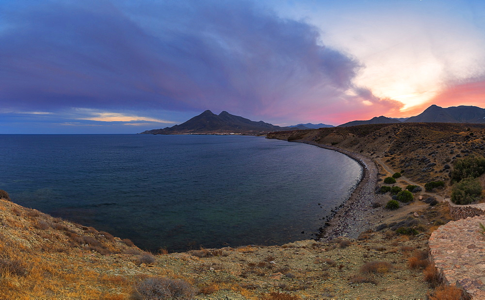 Elevated view of coastline La Isleta del Moro at dusk, Cabo de Gata National Park, Níjar, Almeria province, Andalucia, Spain
