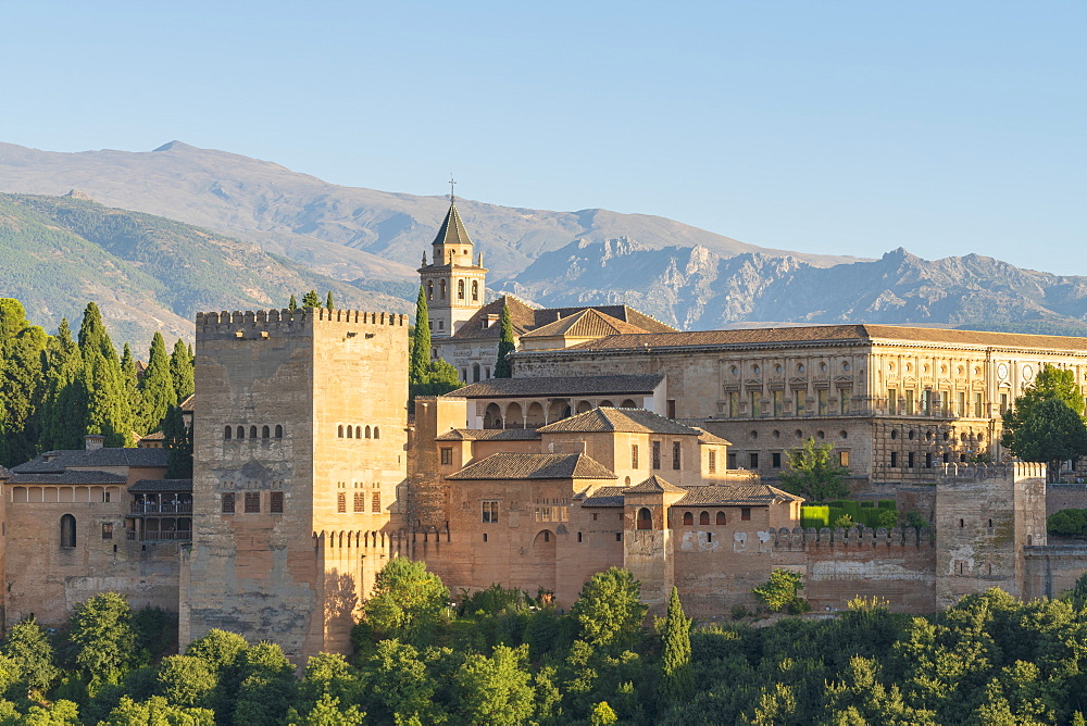 Moorish and Mudejar architecture of the arabic Alhambra palace and fortress at sunset, Granada, Andalusia, Spain