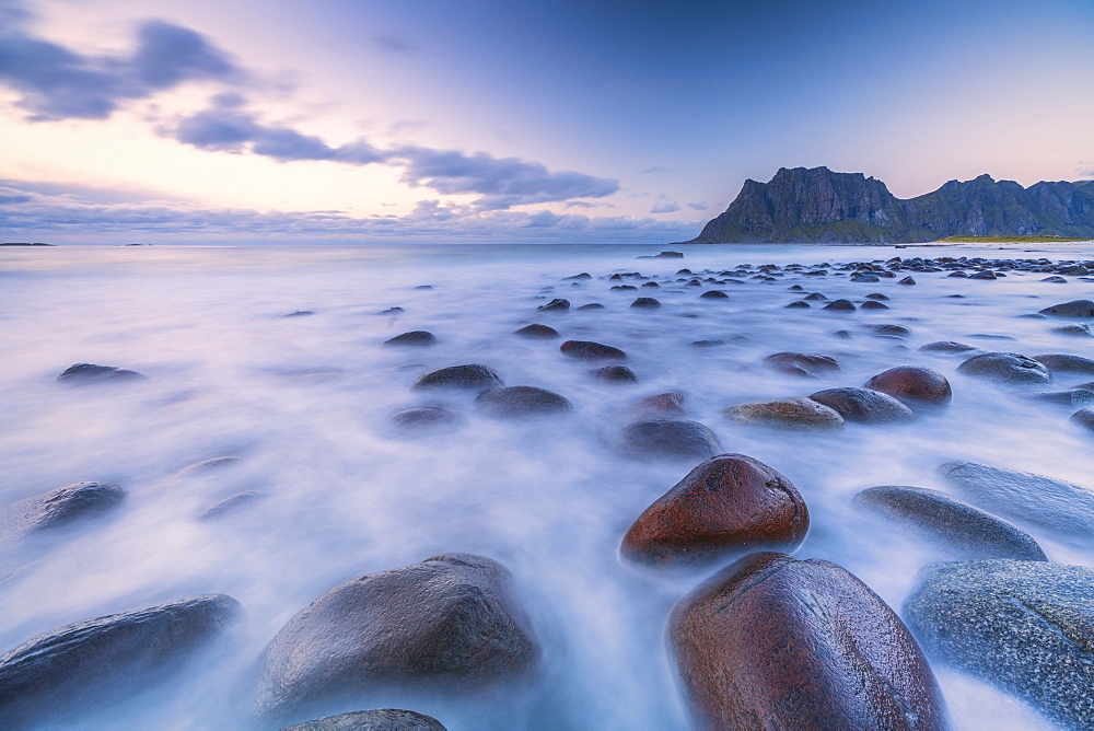 Long exposure shot of rocks on Uttakleiv beach in Vestvagoy, Norway, Europe