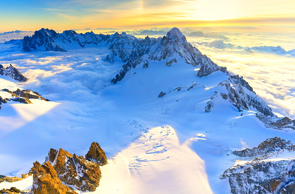 Aerial view of the Grand Jorasses at sunrise, Mont Blanc massif, Courmayeur, Aosta Valley, Italy