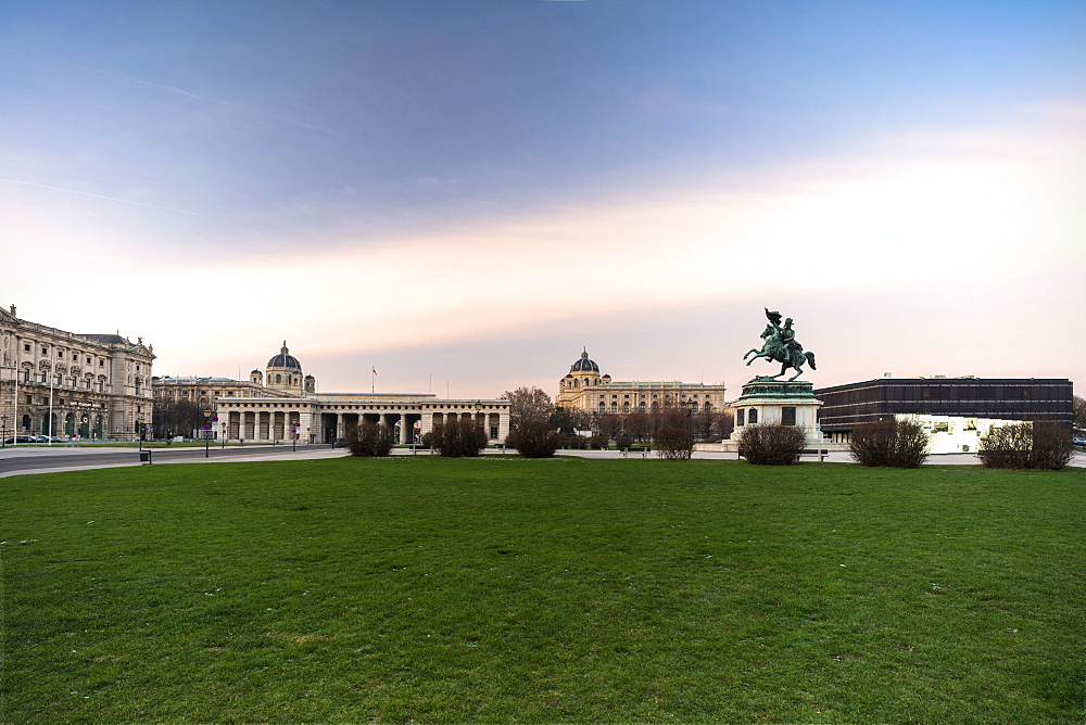 Sunrise over historic buildings and gardens of Heldenplatz (Heroes' Square), Vienna, Austria, Europe