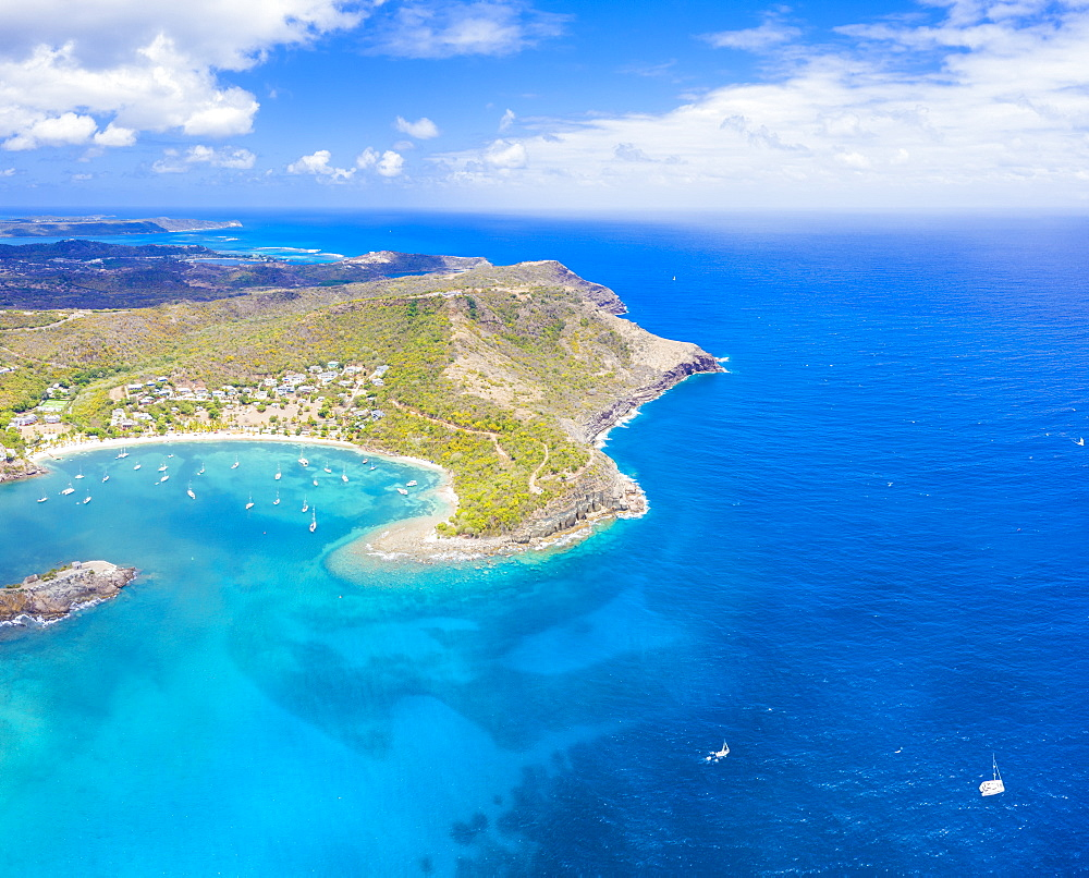 Aerial panoramic by drone of Galleon Beach and Pillar of Hercules limestone cliffs, Antigua, Antigua and Barbuda, Leeward Islands, West Indies, Caribbean, Central America