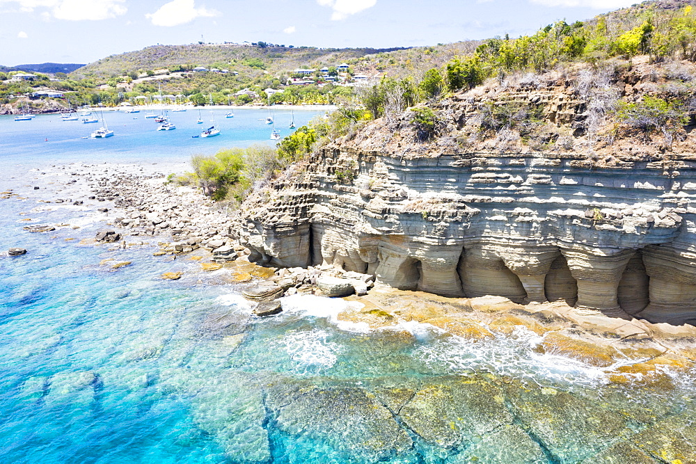 White limestone cliffs Pillar of Hercules washed by Caribbean Sea, aerial view by drone, English Harbour, Antigua, Leeward Islands, West Indies, Caribbean, Central America