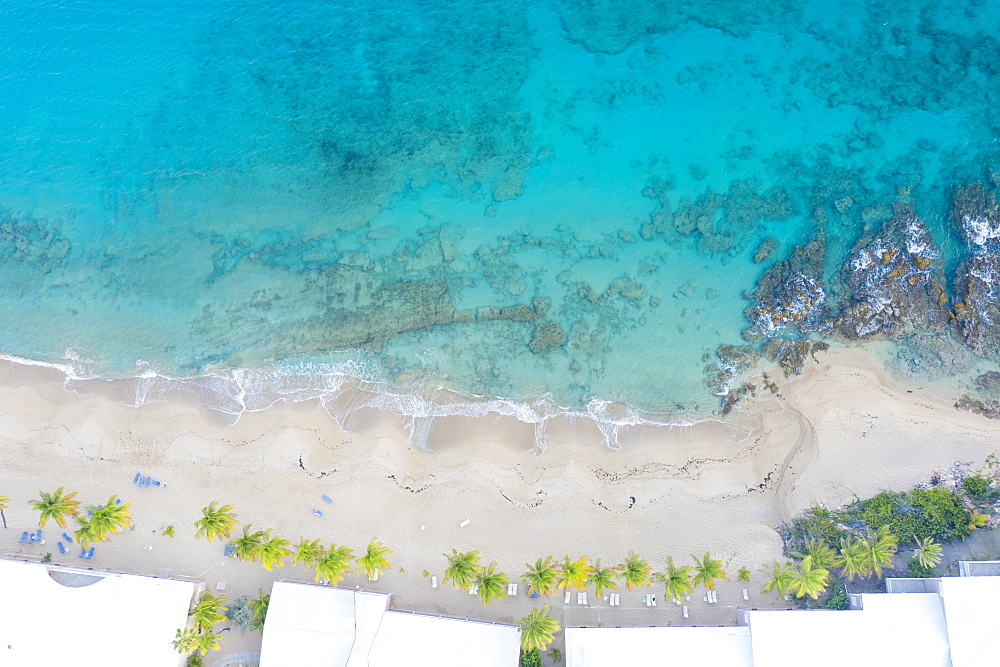 White sand beach washed by waves of Caribbean Sea from above by drone, Morris Bay, Old Road, Antigua, Leeward Islands, West Indies, Caribbean, Central America