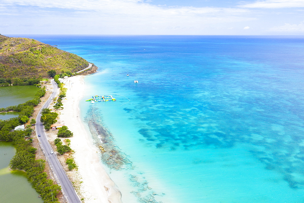 Aerial view by drone of coastal road beside white sand beach, Caribbean, Antilles, West Indies, Caribbean, Central America