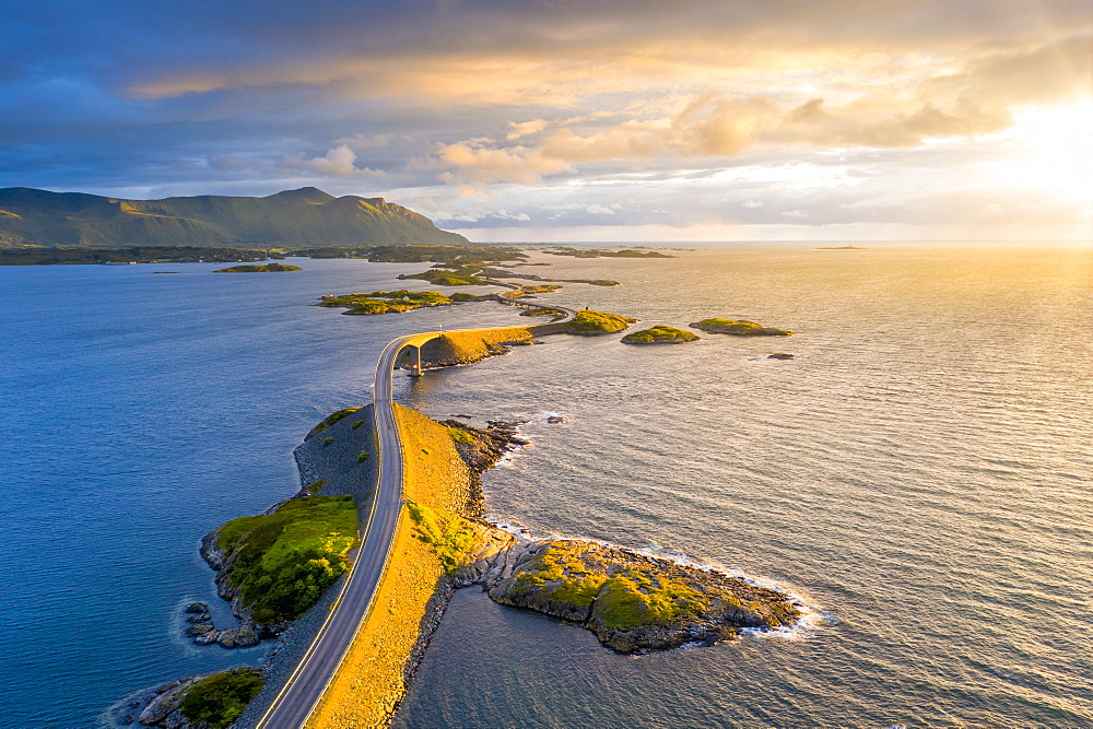 Sunset over Storseisundet Bridge on the Atlantic Road, aerial view, More og Romsdal county, Norway (drone)