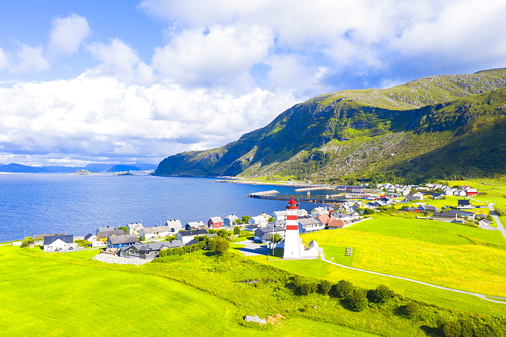 Aerial view by drone of Alnes Lighthouse and village, Godoya Island, Alesund, More og Romsdal County, Norway, Scandinavia, Europe