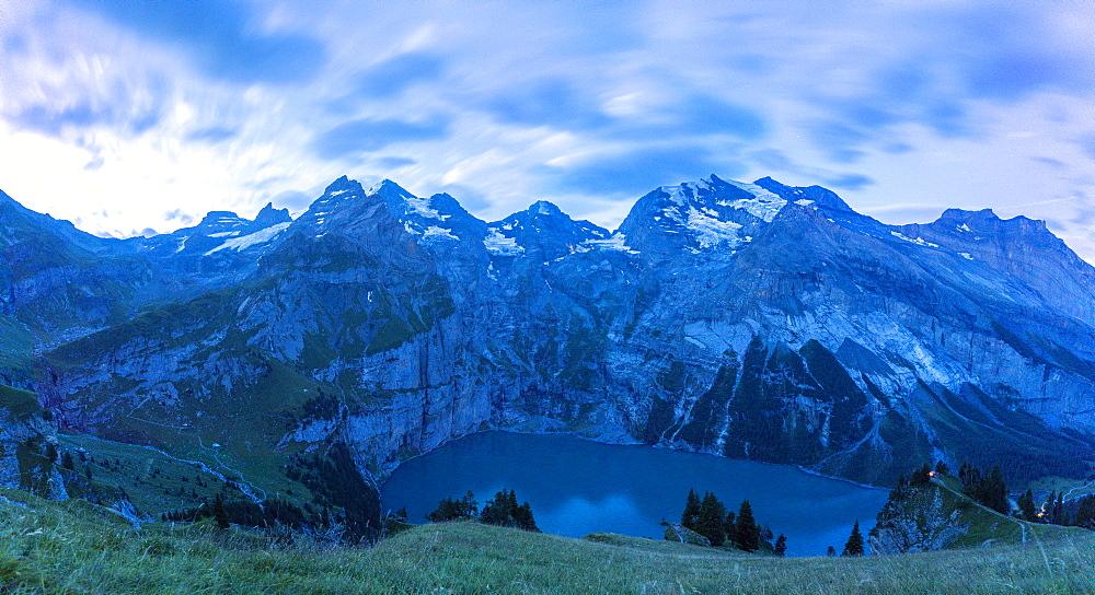 Clouds at dusk over Oeschinensee lake, Bernese Oberland, Kandersteg, Canton of Bern, Switzerland