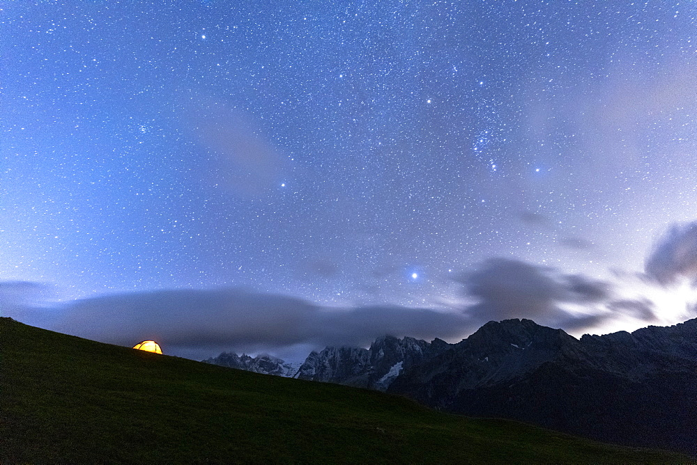 Camping tent under the stars facing Piz Badile and Piz Cengalo, Tombal, Soglio, Val Bregaglia, Canton of Graubunden, Switzerland, Europe - 1179-4047