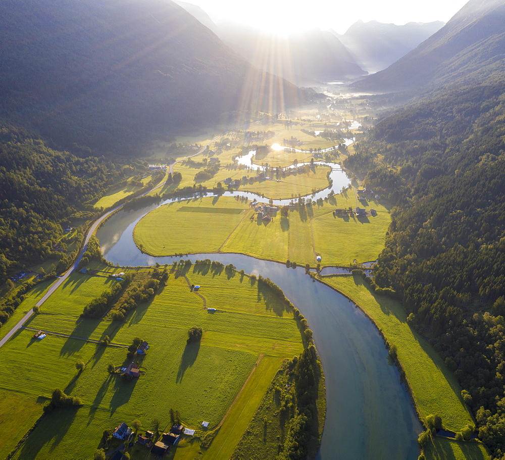 Aerial panoramic of Stryneelva river and fields during a misty sunrise, Stryn, Nordfjorden, Sogn og Fjordane county, Norway, Scandinavia, Europe