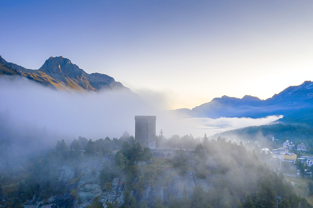 Aerial view by drone of mist over Torre Belvedere in autumn, Maloja Pass, Engadine, Canton of Graubunden, Switzerland, Europe