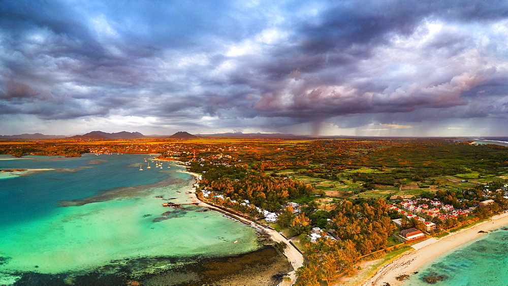 Dramatic sky at dawn over Trou d'Eau Douce coastline, aerial view, Flacq district, East coast, Mauritius, Indian Ocean, Africa