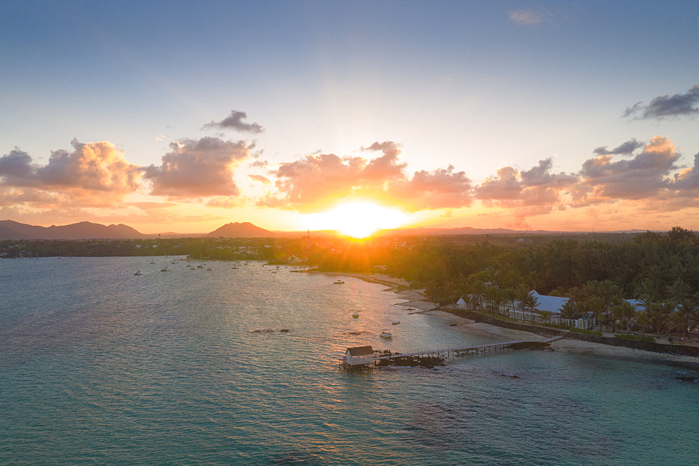 African sunset over tropical lagoon and pier, aerial view, Trou d'Eau Douce, Flacq district, East coast, Mauritius, Indian Ocean, Africa