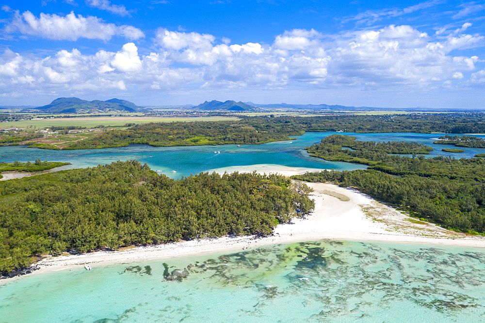 White sand beach with turquoise sea surrounded by tropical trees, Ile Aux Cerfs, Flacq, Indian Ocean, Mauritius (drone)