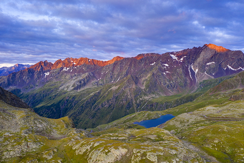 Aerial panoramic of Cima di Pietrarossa and Lago Nero at dawn, Gavia Pass, Valcamonica, Lombardy, Italy, Europe