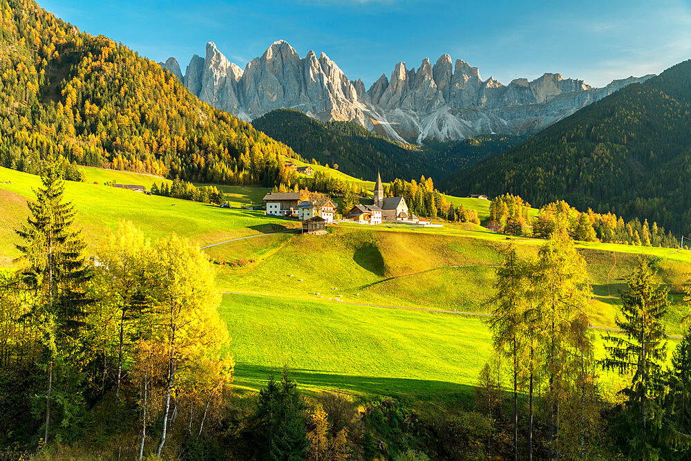 Sunset over the Odle Group and village of Santa Magdalena, Funes Valley, Dolomites, Bolzano province, South Tyrol, Italy