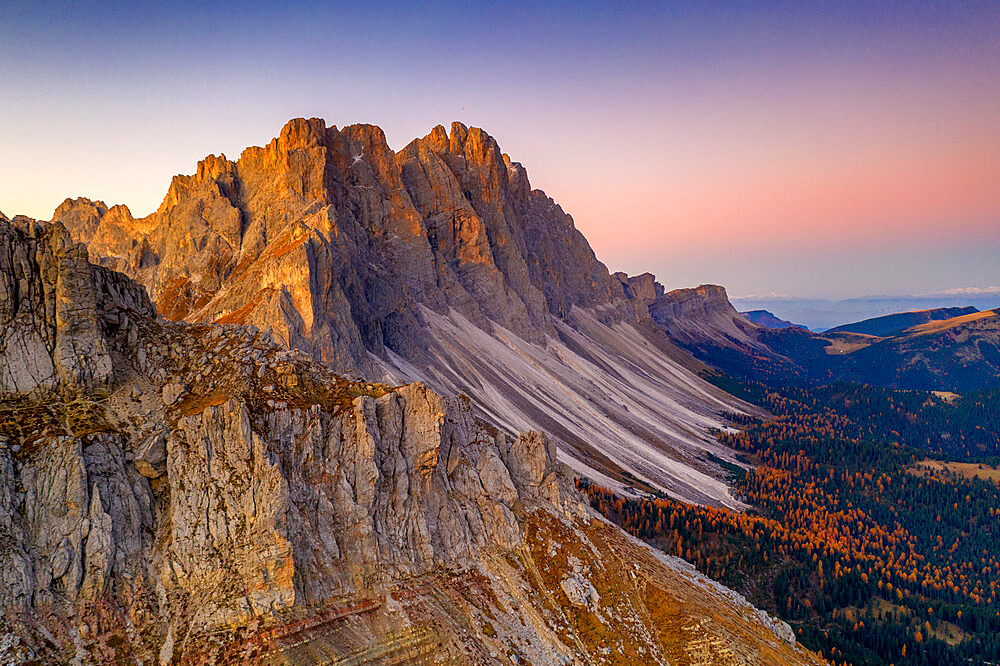 Autumn trees at feet of Furchetta and Sass Rigais, aerial view, Puez-Odle, Funes Valley, Dolomites, Bolzano, South Tyrol, Italy