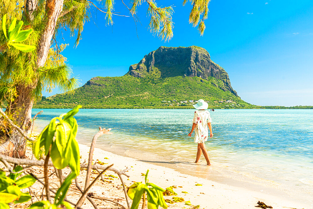 Woman walking on tropical sand beach, Ile aux Benitiers, La Gaulette, Le Morne, Black River, Mauritius, Indian Ocean, Africa
