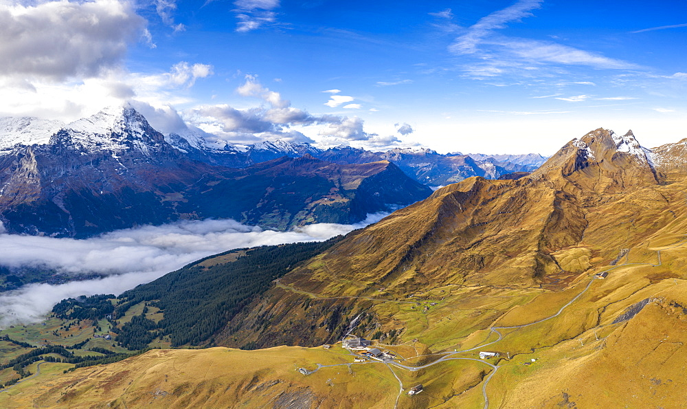 Aerial panoramic of Eiger and sea of clouds surrounding First and Grindelwald in autumn, Bernese Alps, Canton of Bern, Switzerland, Europe