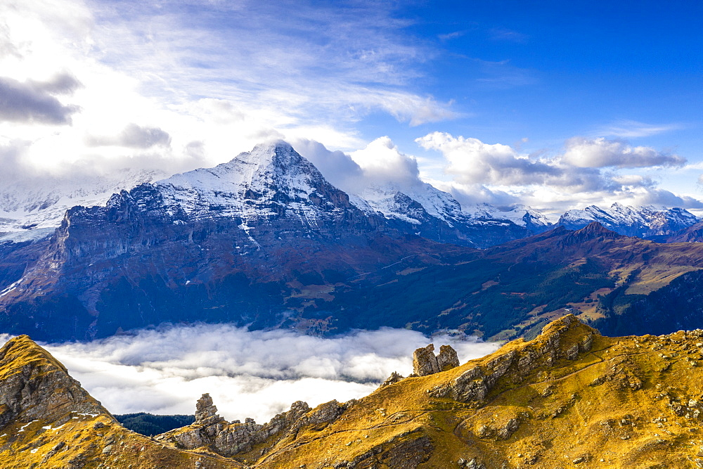 Cloudy sky over Mount Eiger seen from high mountains above Grindelwald in autumn, aerial view, Canton of Bern, Switzerland