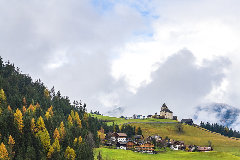 Ciastel de Tor surrounded by woods in autumn, San Martino in Badia, Val Badia, Dolomites, South Tyrol, Italy, Europe