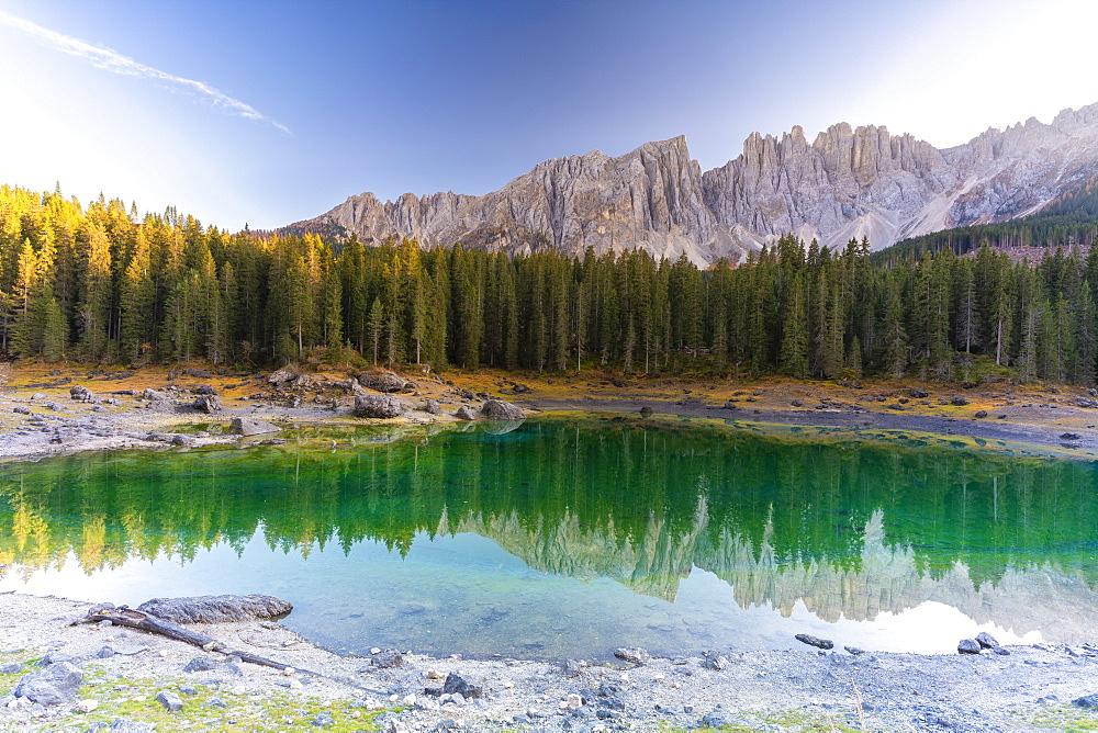 Sunset over Carezza Lake and Latemar mountain range, Dolomites, South Tyrol, Italy