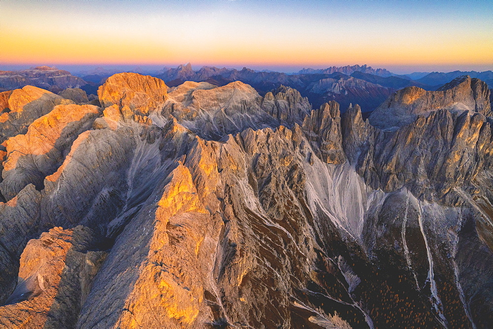 Aerial view of Torri Del Vajolet and Catinaccio Group lit by the autumn sunset, Dolomites, South Tyrol, Italy, Europe