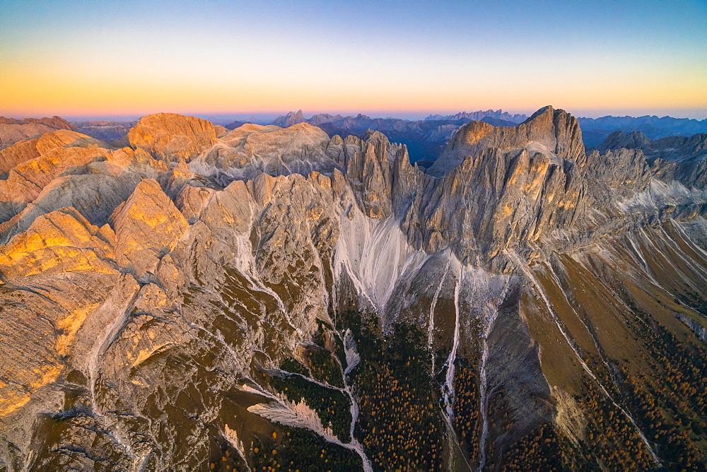 Aerial view of autumn sunset over Torri Del Vajolet, Catinaccio Group and Roda di Vael, Dolomites, South Tyrol, Italy, Europe