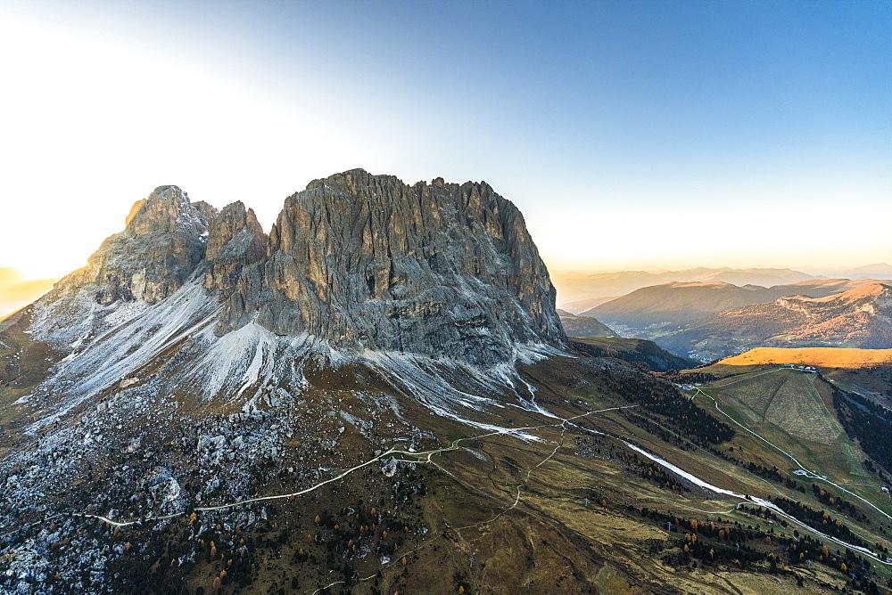 Aerial view of sunset on Sassolungo, Sassopiatto and Passo Gardena in autumn, Dolomites, South Tyrol, Italy, Europe
