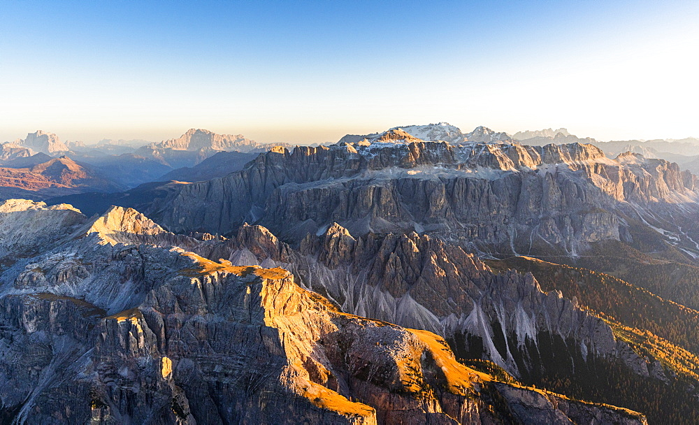 Aerial view of autumn sunset on rocky peaks of Sella Group, Val Gardena, Val di Fassa, Dolomites, South Tyrol, Italy, Europe