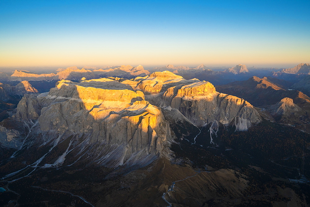 Aerial view of sunset over Sella Group and Sass Pordoi in autumn, Val Gardena, Val di Fassa, Dolomites, South Tyrol, Italy, Europe