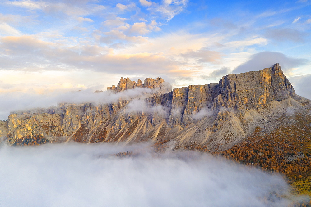 Aerial view by drone of mist at sunset over Lastoi De Formin and Cima Ambrizzola in autumn, Giau Pass, Dolomites, Belluno, Veneto, Italy, Europe