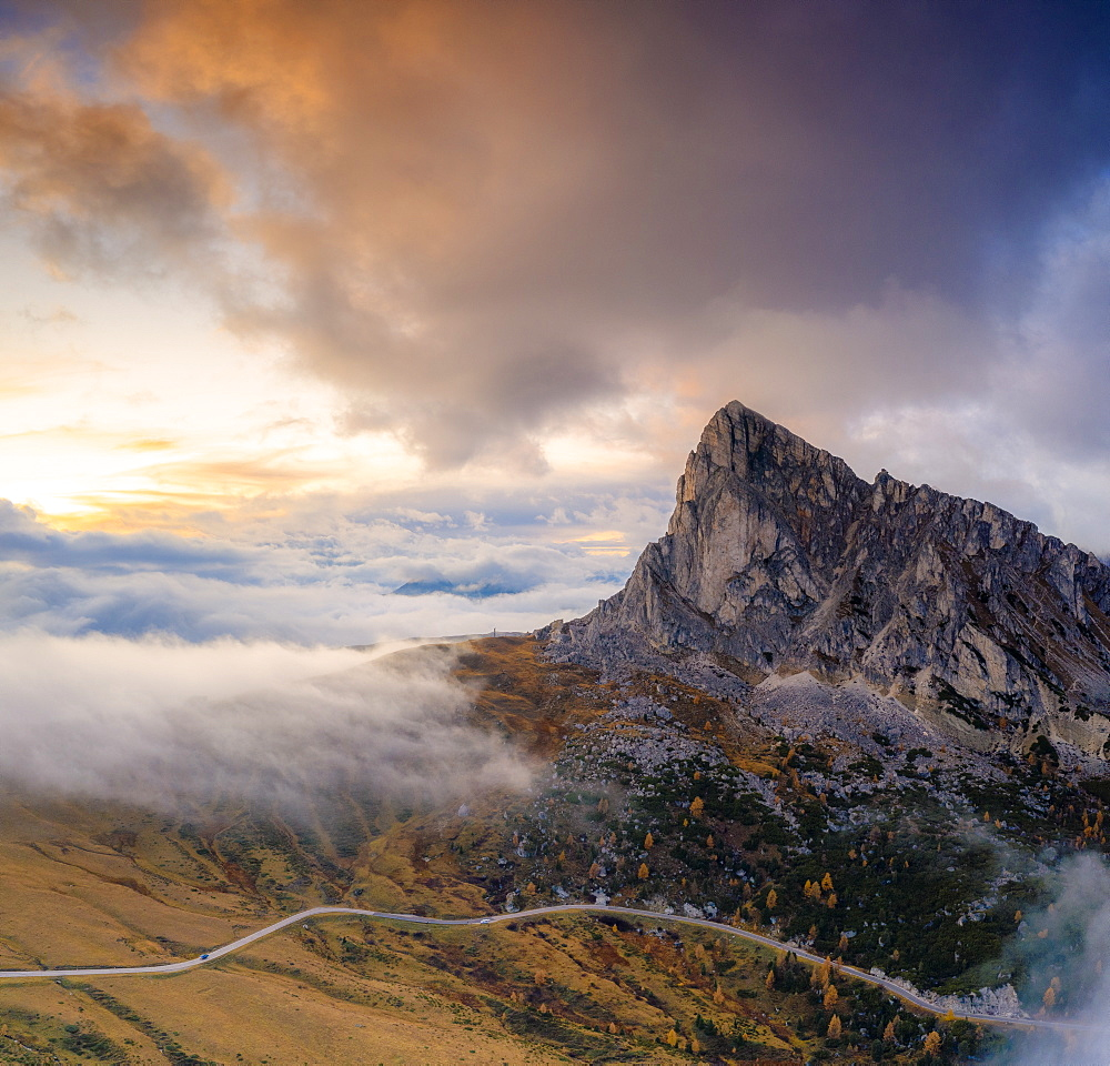 Aerial view by drone of foggy sky at sunset over Ra Gusela and Giau Pass in autumn, Dolomites, Belluno, Veneto, Italy, Europe