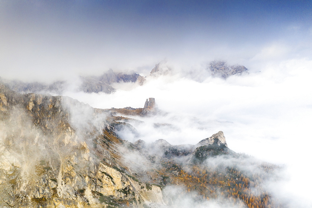 Aerial view of autumn mist over the trees and woods surrounding Cinque Torri and Tofane, Giau Pass, Dolomites, Belluno, Veneto, Italy, Europe