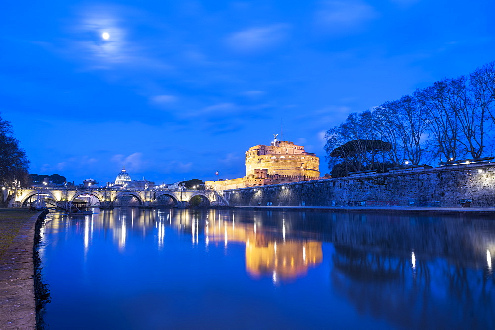 Moonlight at dusk on river Tiber, Ponte and Castel Sant'Angelo, Rome, Lazio, Italy