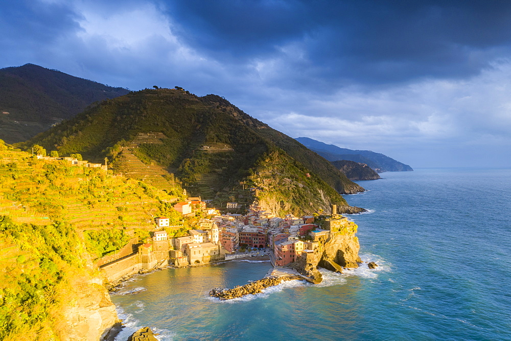 Aerial view of clouds at sunset over the coastal village of Vernazza, Cinque Terre, UNESCO World Heritage Site, La Spezia province, Liguria, Italy, Europe