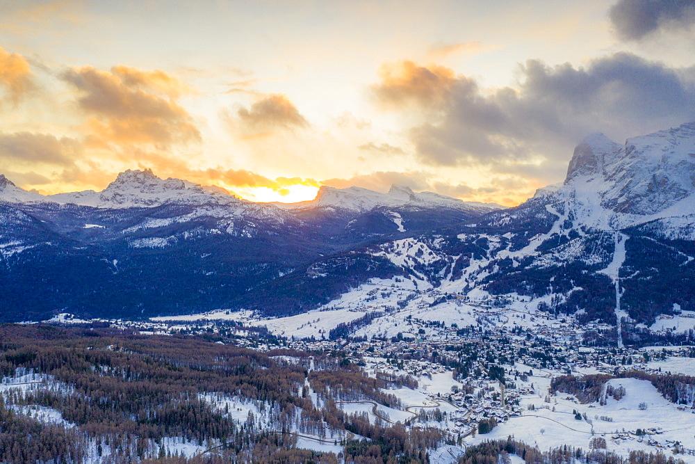 Sunrise over Cortina d'Ampezzo in the snowy landscape, aerial view, Dolomites, Belluno province, Veneto, Italy