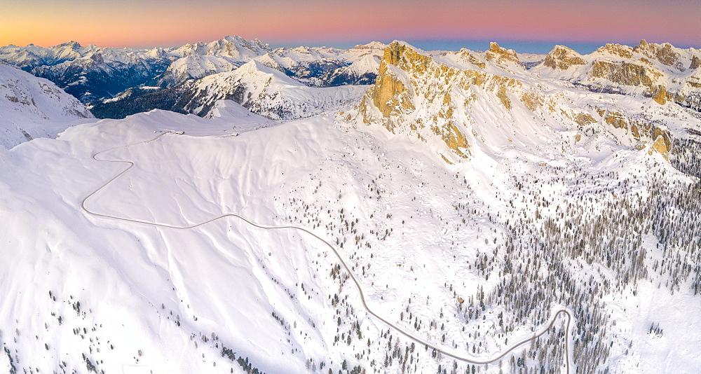 Panoramic view by drone of the snowy Giau Pass, Marmolada, Ra Gusela, Nuvolau, Averau and Lagazuoi at dawn, Dolomites, Veneto, Italy, Europe