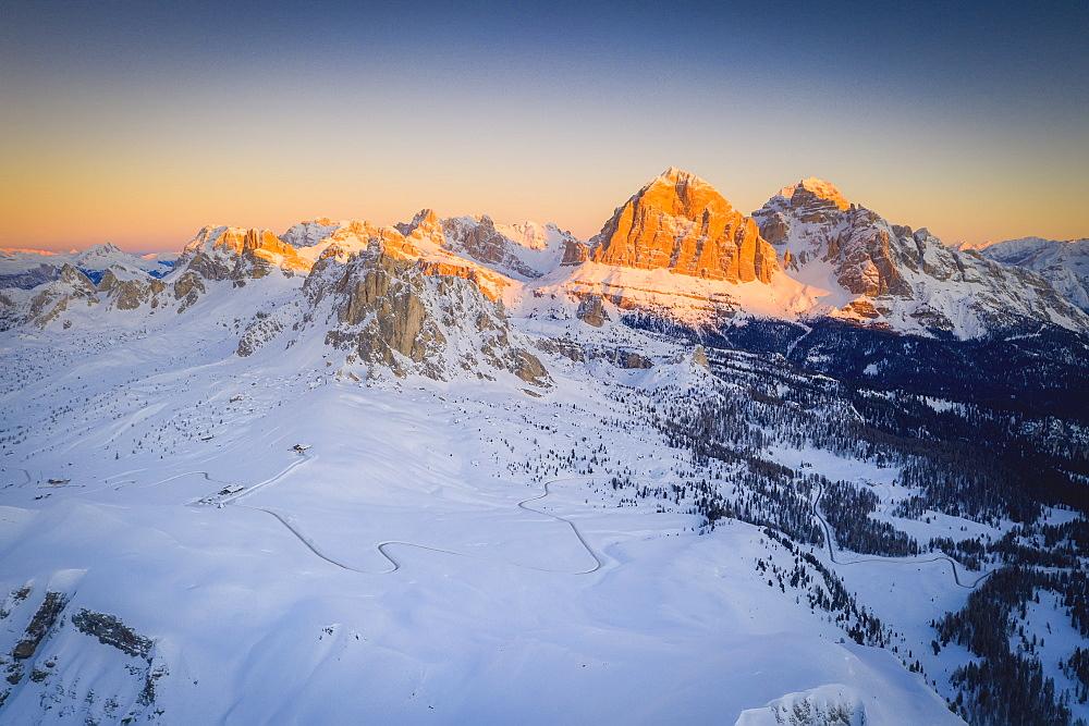 View by drone of Giau Pass, Ra Gusela, Nuvolau, Averau and Tofane at sunrise in winter, Dolomites, Belluno province, Veneto, Italy, Europe