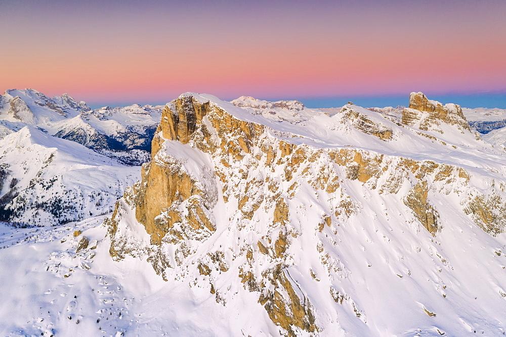 Pink sky at sunrise on Ra Gusela, Nuvolau, Averau, Marmolada covered with snow, Dolomites, Belluno, Veneto, Italy (drone) - 1179-4357