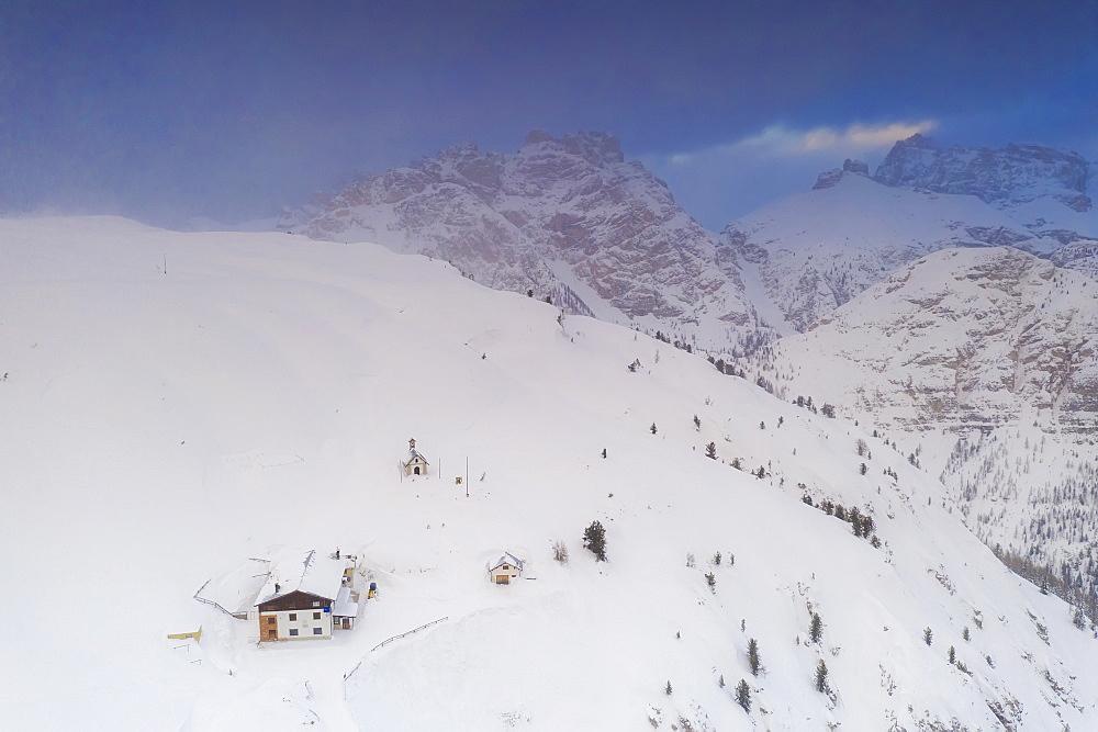 View by drone of Rifugio Bosi hut on top of Monte Piana covered with snow, Dolomites, Auronzo di Cadore, Belluno, Veneto, Italy, Europe