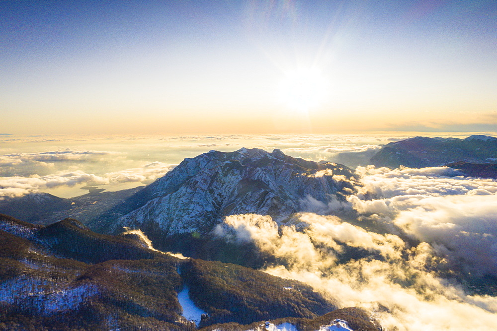 Monte Coltignone in a sea of clouds seen from Piani Resinelli, aerial view, Lake Como, Lecco province, Lombardy, Italy