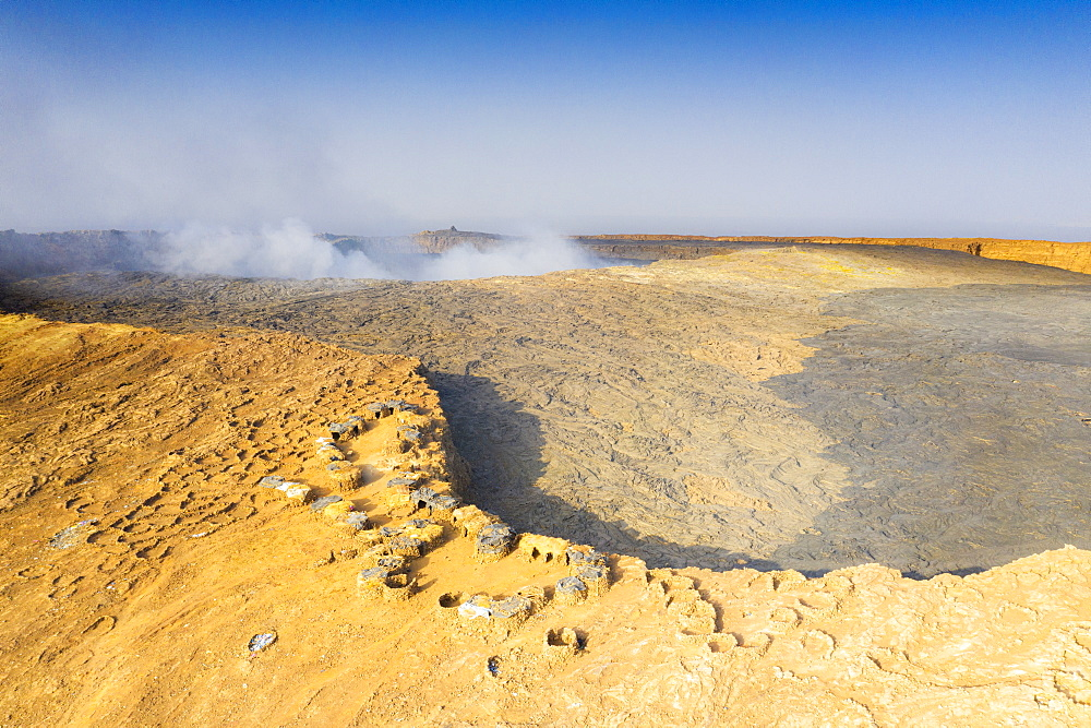 Aerial view of stone huts on top of majestic Erta Ale volcano, Danakil Depression, Afar Region, Ethiopia, Africa
