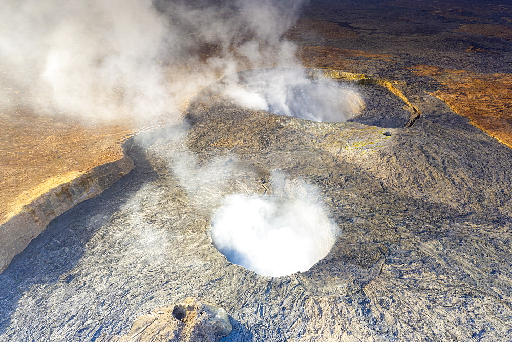 Smoke over the two craters of Erta Ale volcano summit caldera, Danakil Depression, Afar Region, Ethiopia, Africa