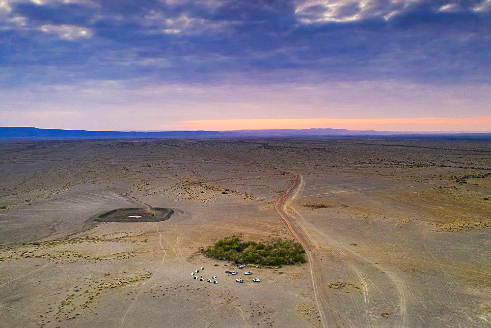 Aerial view by drone of jeeps and camping tents in the desert, Semera, Afar Region, Ethiopia, Africa